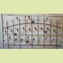Grande grille arrondie avec oiseaux et feuilles